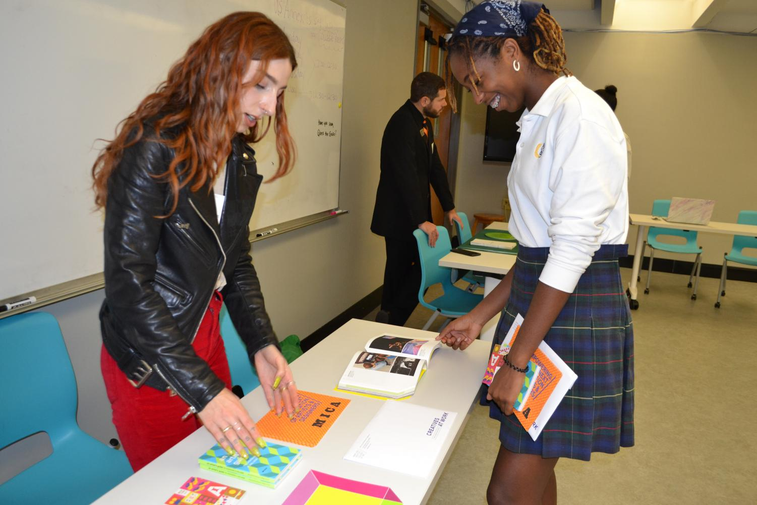 Zora Cokes '22, talks to a representative from Maryland Institute College of Art
